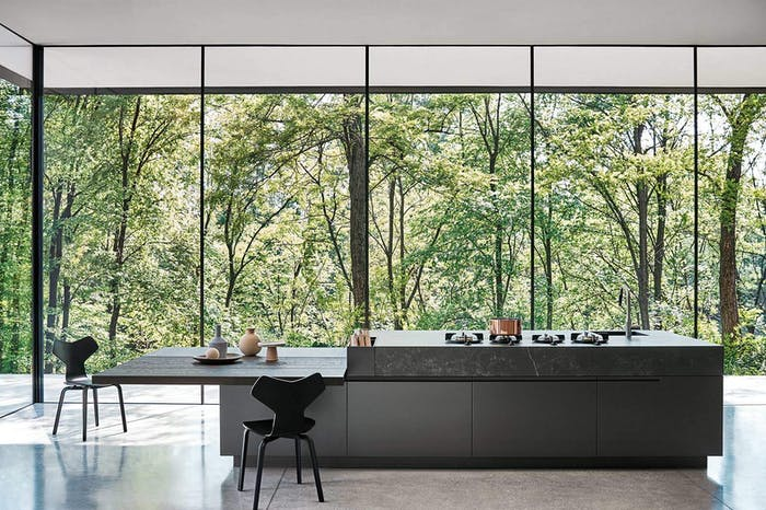"Modern kitchen with view to the outdoors, great example of biophilic design.<span class=""sr-only""> (opened in a new window/tab)</span>"