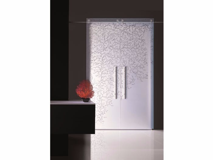 """Sliding door with a coral patter impressed, great example of biophilic design.<span class=""""sr-only""""> (opened in a new window/tab)</span>"""