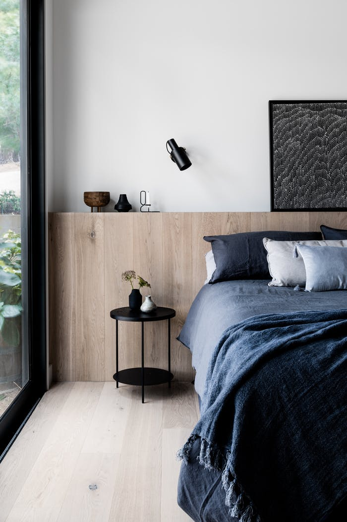 "Minimalist bedroom with big window, great example of biophilic design.<span class=""sr-only""> (opened in a new window/tab)</span>"