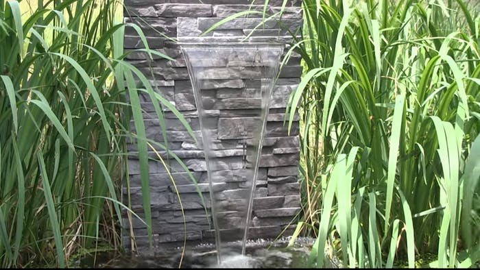 "Wall water fountain, great and easy example of biophilic design.<span class=""sr-only""> (opened in a new window/tab)</span>"