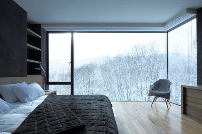 "Bedroom with winter outside view, great example of biophilic design.<span class=""sr-only""> (opened in a new window/tab)</span>"