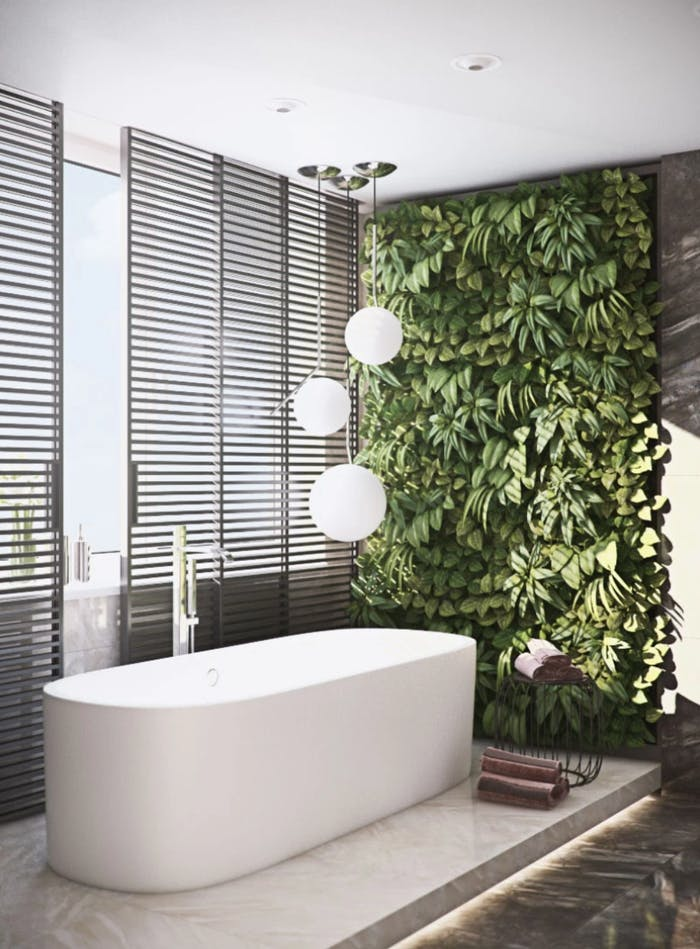 """Modern bathroom with a garden wall design next to the bathtub.<span class=""""sr-only""""> (opened in a new window/tab)</span>"""