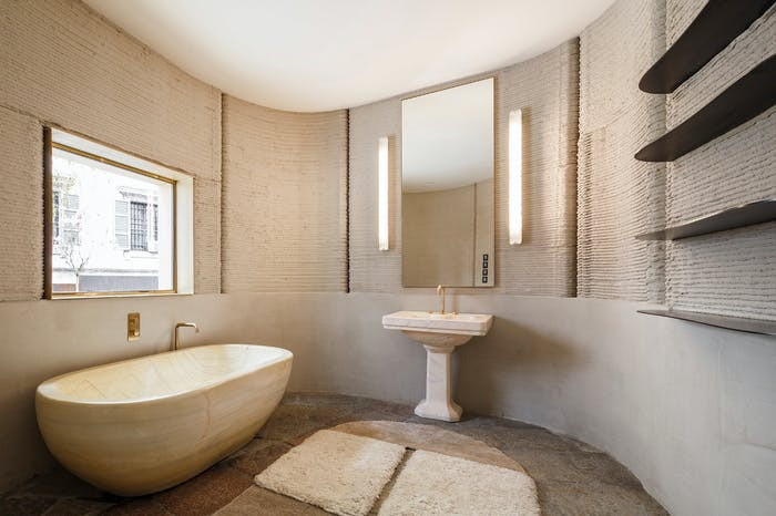 """The interior of 3D Housing 05, an example of sustainable living and energy efficiency. View of the bathroom.<span class=""""sr-only""""> (opened in a new window/tab)</span>"""