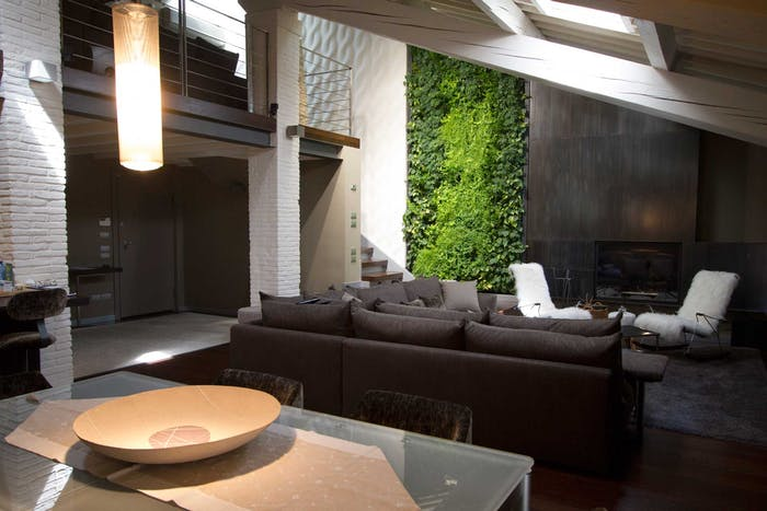 """Full-height garden wall design in a modern apartment.<span class=""""sr-only""""> (opened in a new window/tab)</span>"""