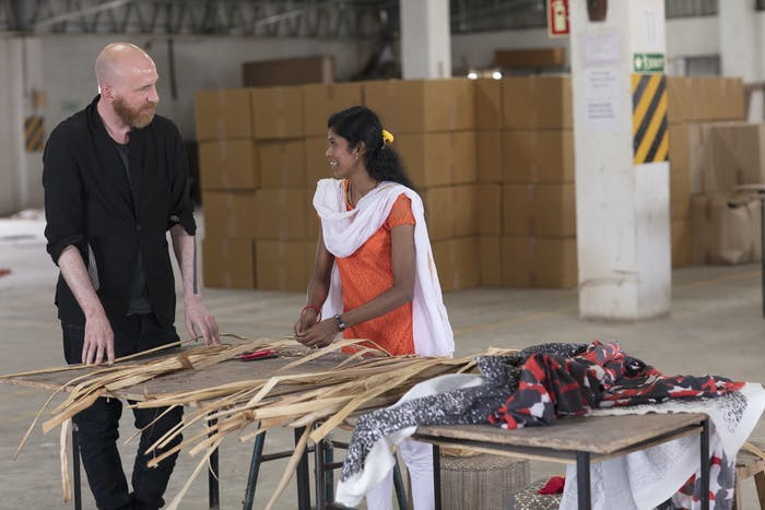 "An Indian artisan talking with the IKEA designer responsible for ANNASTANS collection.<span class=""sr-only""> (opened in a new window/tab)</span>"