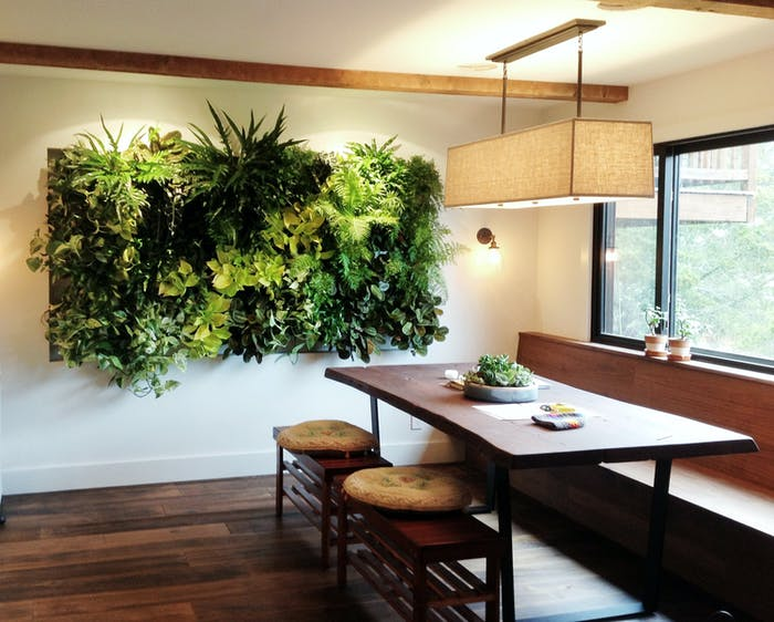 """Garden wall design as a hanging artwork in a dining area.<span class=""""sr-only""""> (opened in a new window/tab)</span>"""