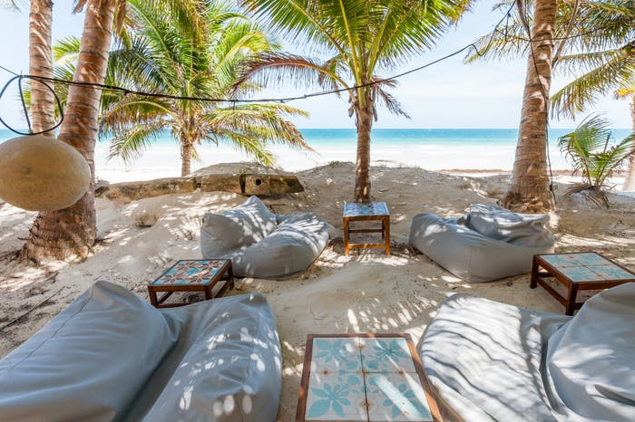 "The outdoor lounging area of Casa Nalum sits directly on the beach.<span class=""sr-only""> (opened in a new window/tab)</span>"