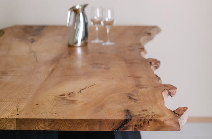 """Wooden table with a live edge.<span class=""""sr-only""""> (opened in a new window/tab)</span>"""