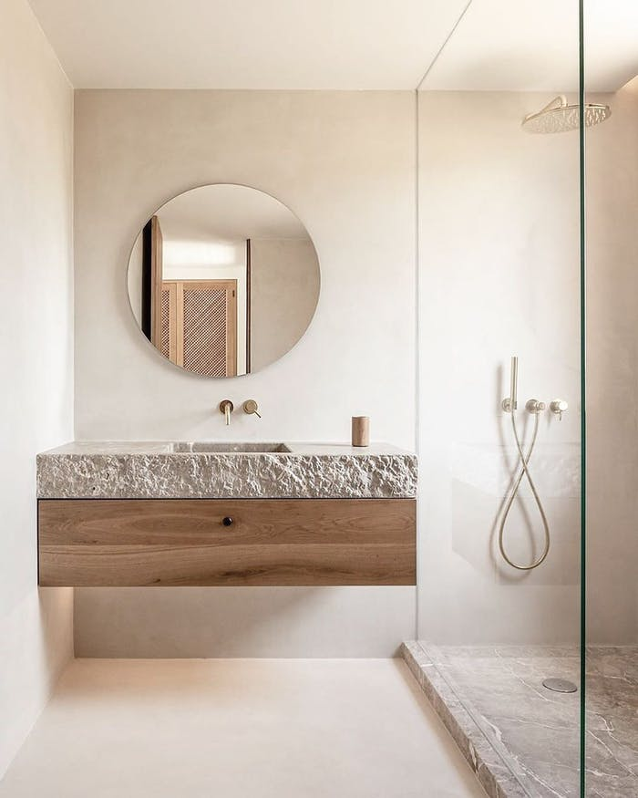 """Biophilic bathroom with stone vanity top with a raw edge.<span class=""""sr-only""""> (opened in a new window/tab)</span>"""