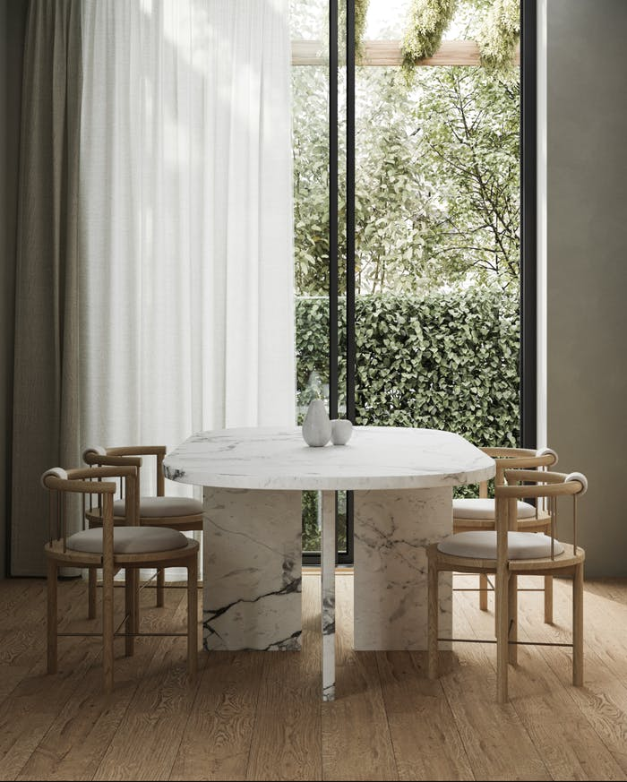 """Biophilic dining area next to a full-height window that looks into a small patch of greenery.<span class=""""sr-only""""> (opened in a new window/tab)</span>"""