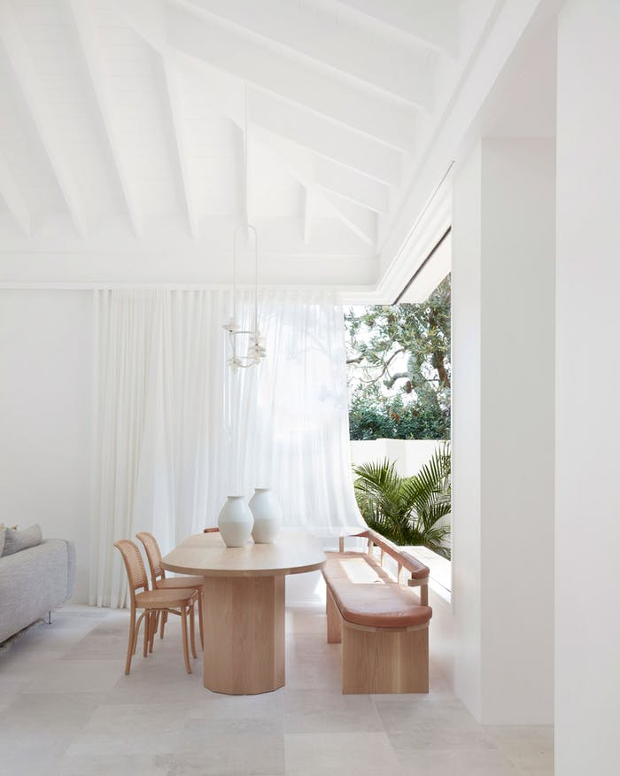"""Biophilic dining area in a white interior.<span class=""""sr-only""""> (opened in a new window/tab)</span>"""