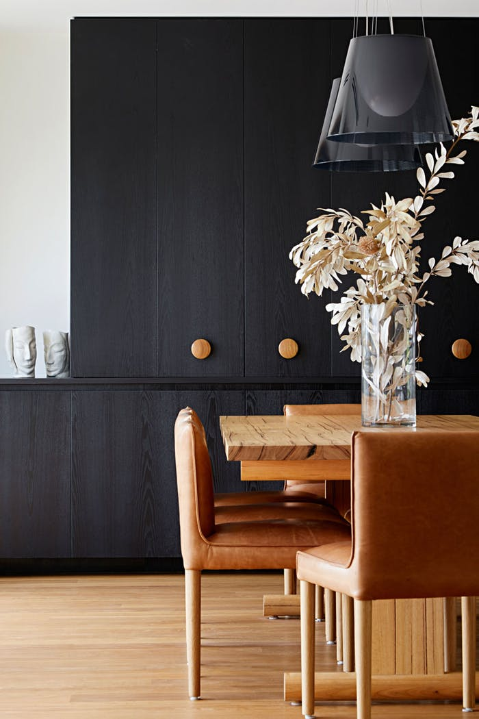 """Biophilic dining area with a black and tan palette that could recall the colours of the local surroundings.<span class=""""sr-only""""> (opened in a new window/tab)</span>"""
