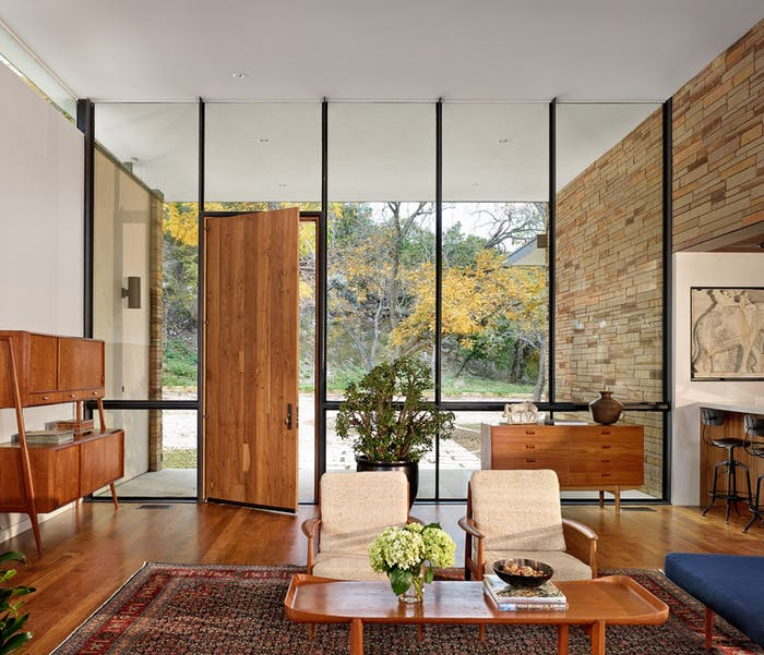 """Biophilic entryway where the front door wall is fully glazed.<span class=""""sr-only""""> (opened in a new window/tab)</span>"""