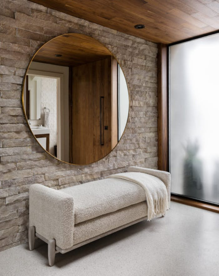"""Contemporary entryway with a stone wall and wood ceiling.<span class=""""sr-only""""> (opened in a new window/tab)</span>"""