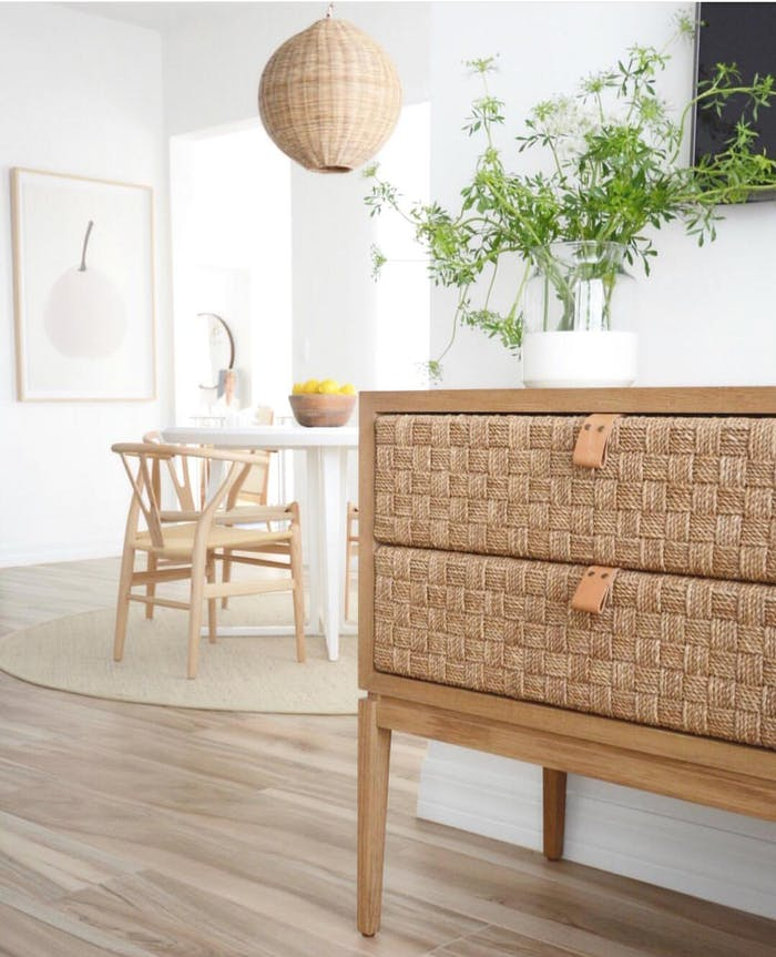 """Biophilic entryway with greenery and woven dresser.<span class=""""sr-only""""> (opened in a new window/tab)</span>"""