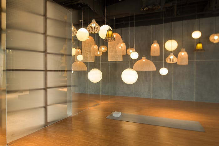 """Airy meditation room with many pendant lights made of natural fibres.<span class=""""sr-only""""> (opened in a new window/tab)</span>"""
