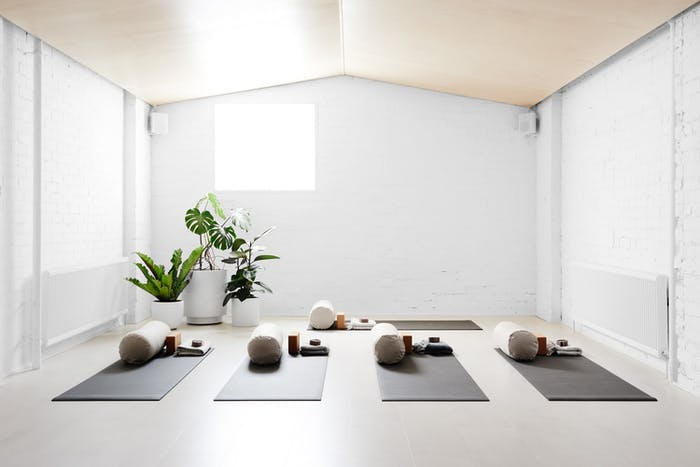 """Total white meditation room with a few plants and plenty of natural light.<span class=""""sr-only""""> (opened in a new window/tab)</span>"""