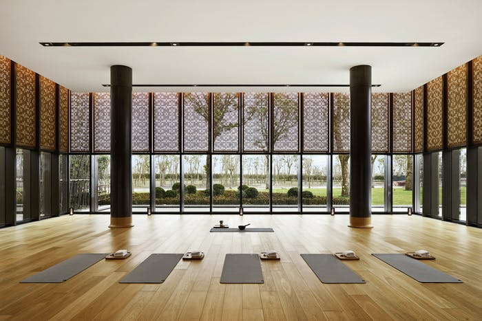 """Big meditation room with huge windows and textures window treatment.<span class=""""sr-only""""> (opened in a new window/tab)</span>"""