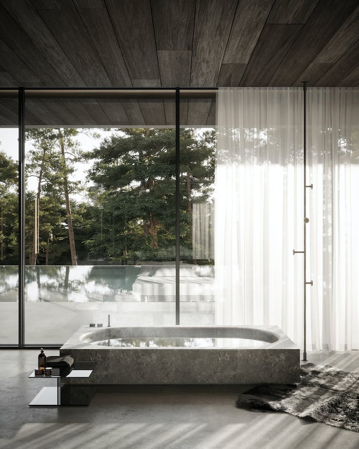 """Biophilic bathroom with bathtub looking out into a pool.<span class=""""sr-only""""> (opened in a new window/tab)</span>"""