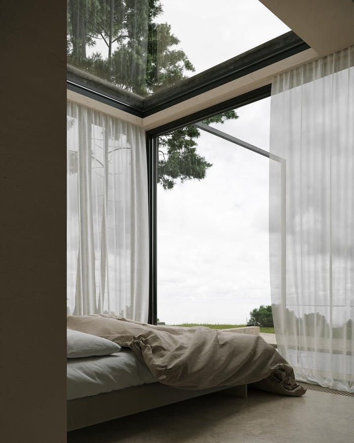 """Biophilic bedroom with glazed walls.<span class=""""sr-only""""> (opened in a new window/tab)</span>"""