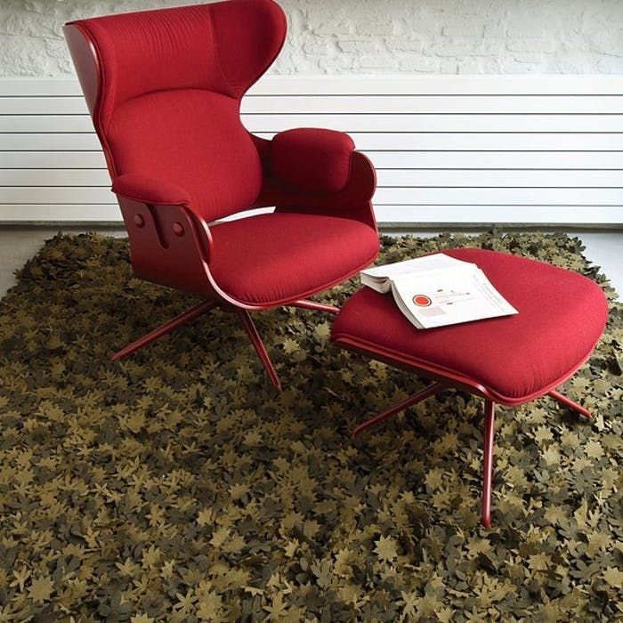 """Red armchair on a rug made with little individual wood felt flowers.<span class=""""sr-only""""> (opened in a new window/tab)</span>"""