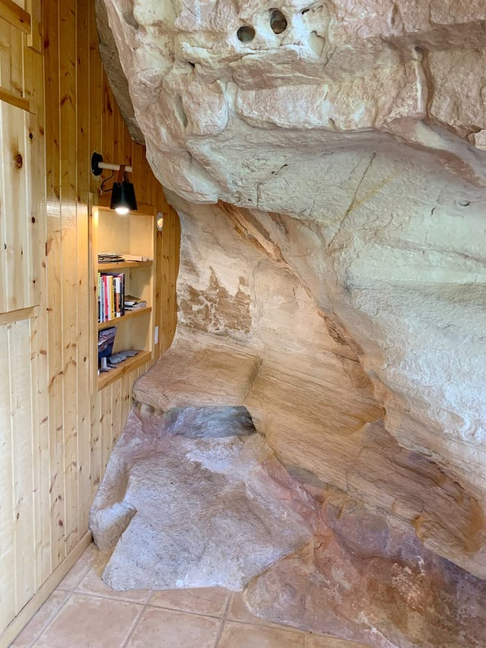 """Reading nook inside a natural nook in the wall.<span class=""""sr-only""""> (opened in a new window/tab)</span>"""