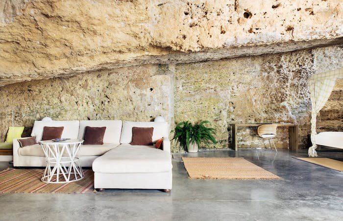 """Living/sleeping area built inside the natural cave.<span class=""""sr-only""""> (opened in a new window/tab)</span>"""
