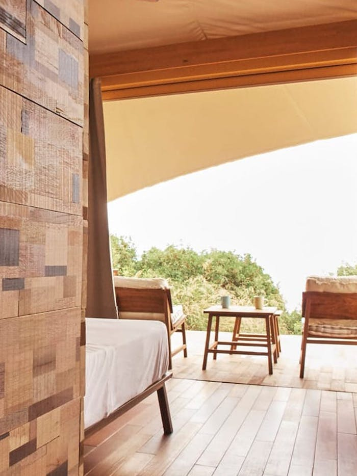 """Back view of the bed and patio, both oriented towards the ocean.<span class=""""sr-only""""> (opened in a new window/tab)</span>"""