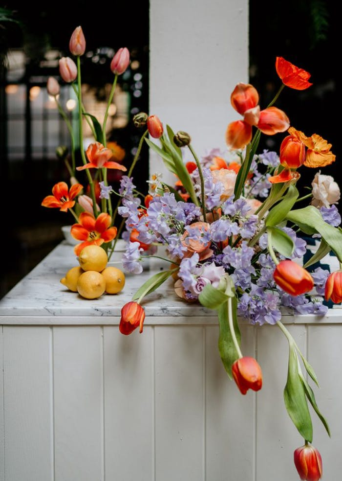 """Biophilic arrangement with colourful spring flowers.<span class=""""sr-only""""> (opened in a new window/tab)</span>"""