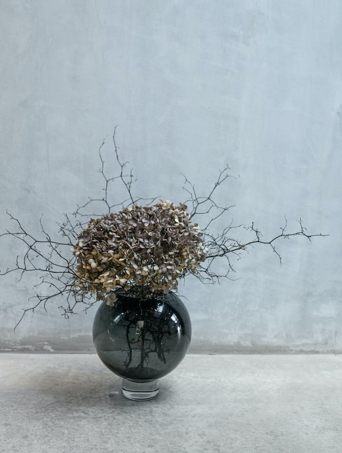 """Branches arranged into a round vase.<span class=""""sr-only""""> (opened in a new window/tab)</span>"""