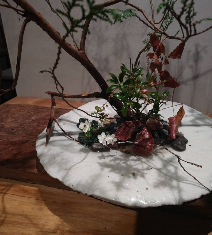 """Simple leaves and branches arranged in ikebana.<span class=""""sr-only""""> (opened in a new window/tab)</span>"""