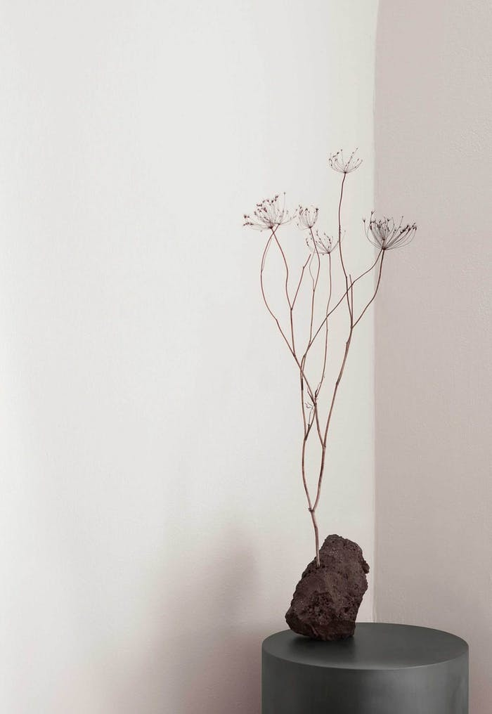 """Tall dried flowers arranged into a stoned shaped vase.<span class=""""sr-only""""> (opened in a new window/tab)</span>"""