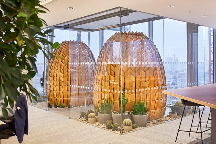 "Wooden retreat pods in a biophilic office with a shape that recalls a pinecone.<span class=""sr-only""> (opened in a new window/tab)</span>"