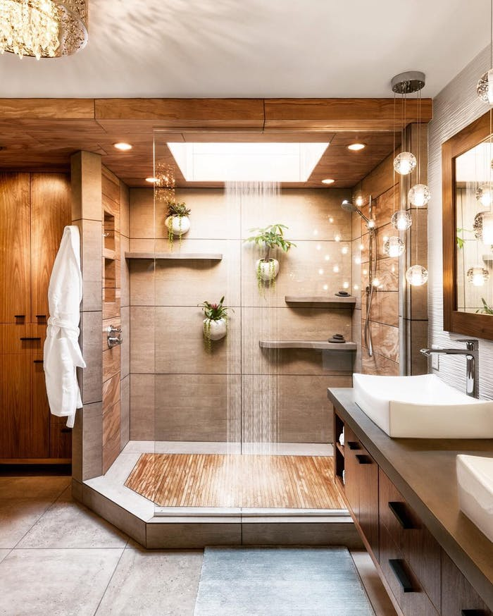 """Natural bathroom design with plants hang on the wall into the shower.<span class=""""sr-only""""> (opened in a new window/tab)</span>"""
