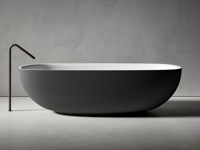 """Bathtub with an oval shape and rounded floor-mounted faucet.<span class=""""sr-only""""> (opened in a new window/tab)</span>"""