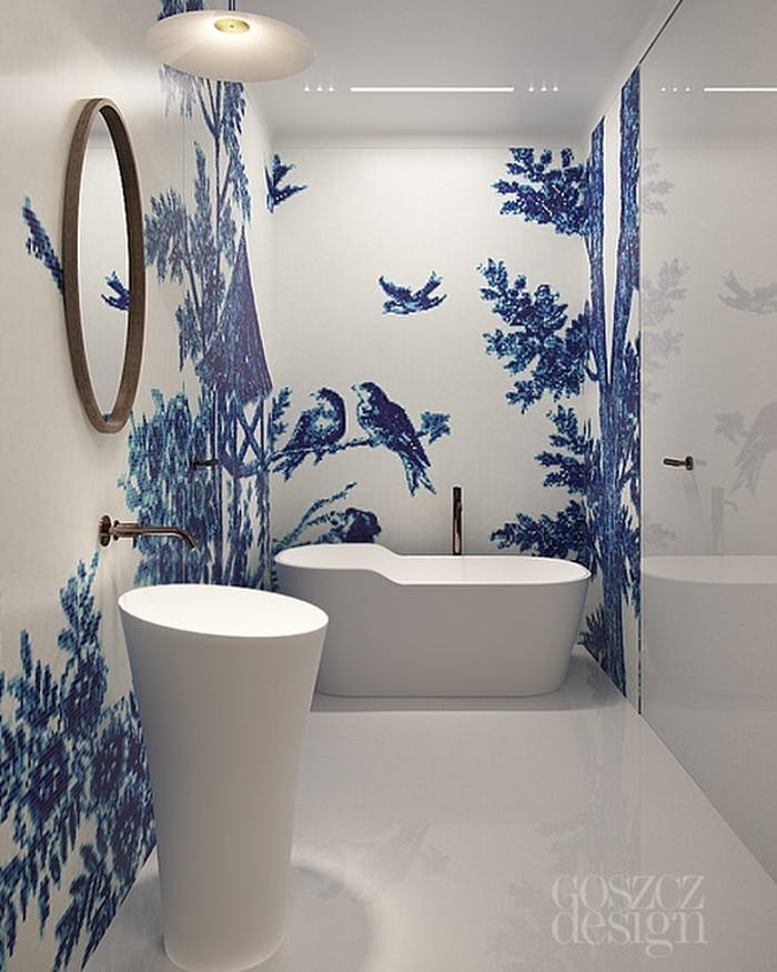 """Total white bathroom with blue mosaic wall finish representing birds and branches.<span class=""""sr-only""""> (opened in a new window/tab)</span>"""