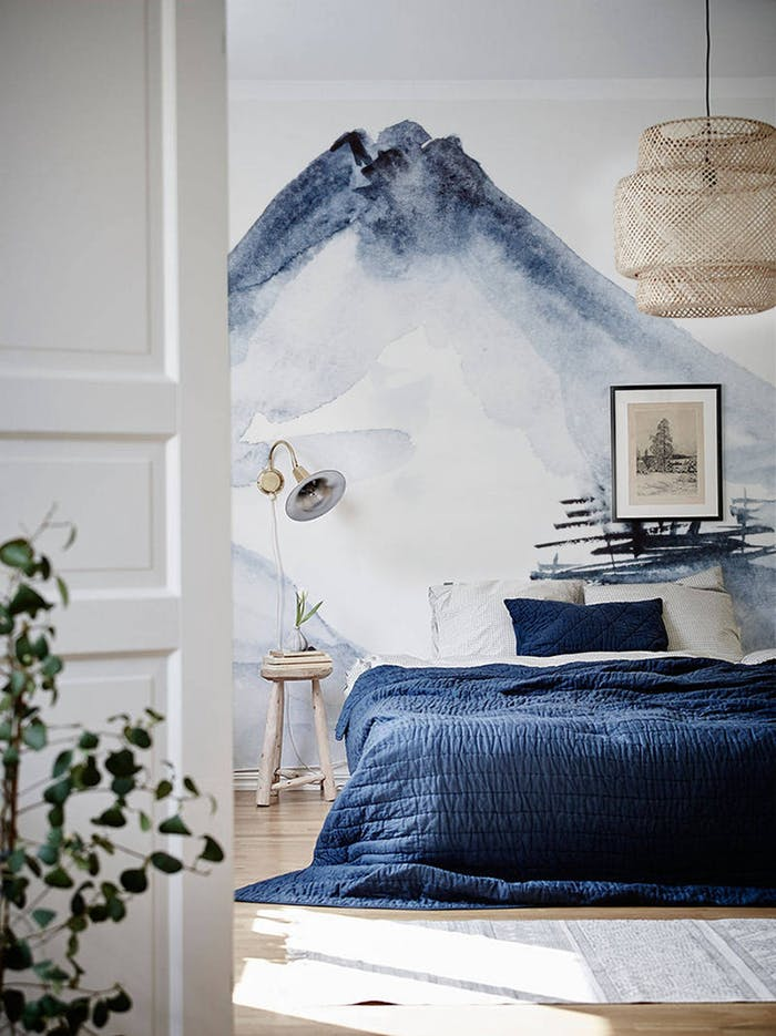 """Bedroom with blue watercolour mural on the back wall.<span class=""""sr-only""""> (opened in a new window/tab)</span>"""