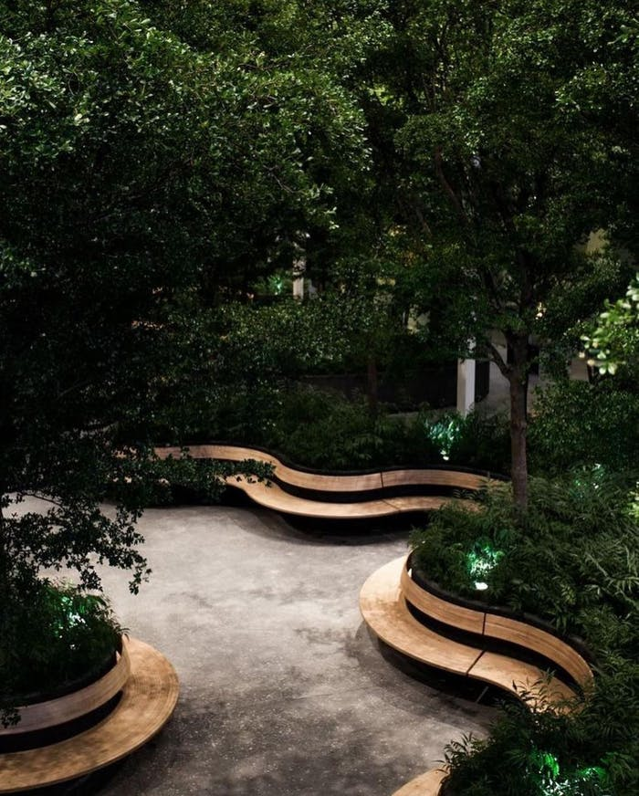 """Communal area with rounded benches creating individual refuge areas.<span class=""""sr-only""""> (opened in a new window/tab)</span>"""