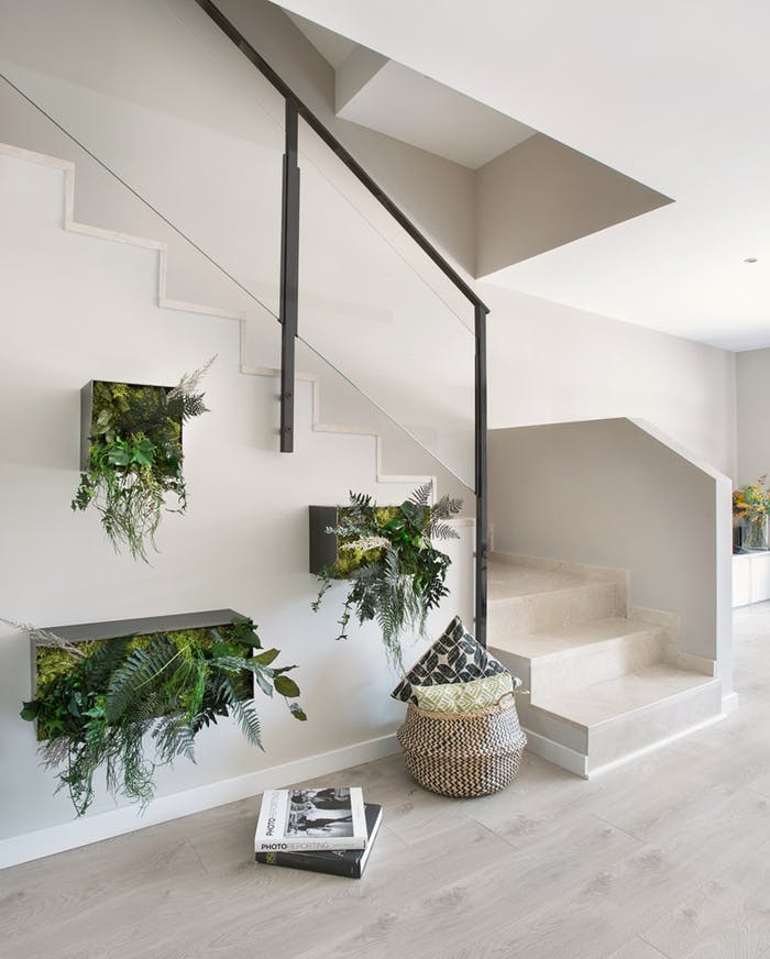 """Metal crates hung on the wall containing plants.<span class=""""sr-only""""> (opened in a new window/tab)</span>"""