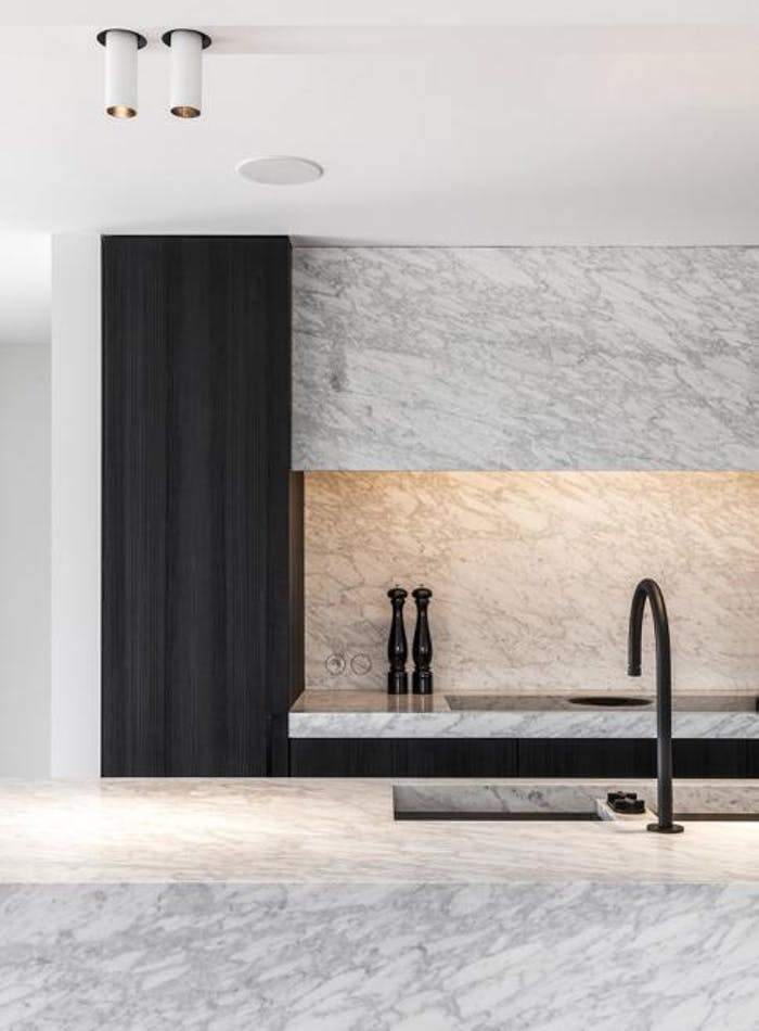 """Kitchen with stone finish with a texture that recalls flowy water.<span class=""""sr-only""""> (opened in a new window/tab)</span>"""