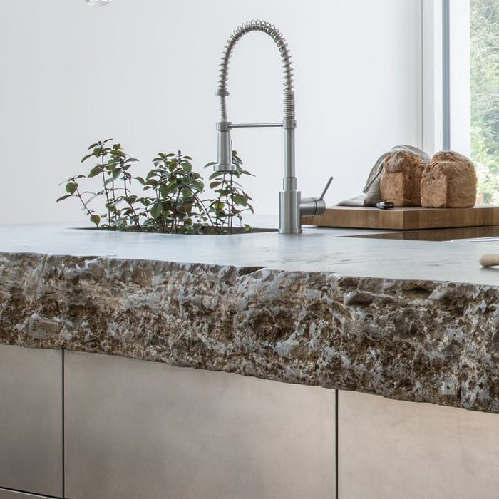 """Stone kitchen countertop with textured edge.<span class=""""sr-only""""> (opened in a new window/tab)</span>"""