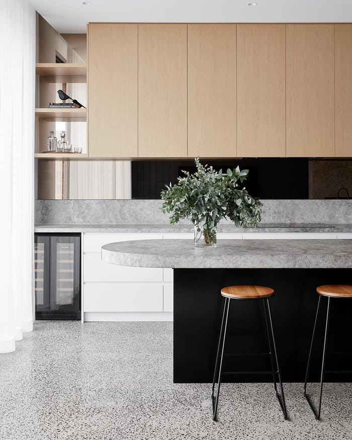 """Contemporary kitchen island with stools.<span class=""""sr-only""""> (opened in a new window/tab)</span>"""