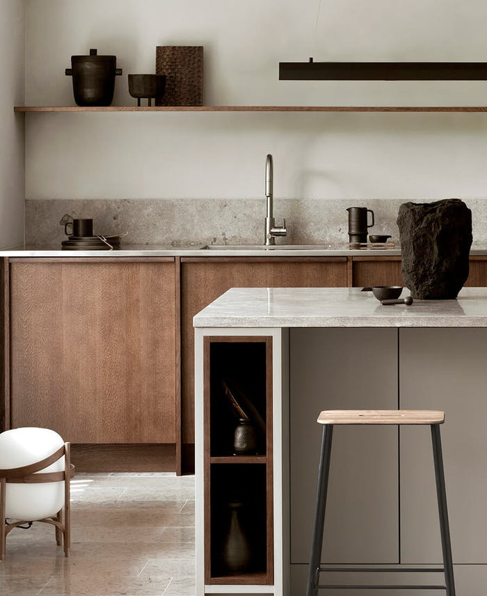 """Kitchen with sculpural storage vessels at sight.<span class=""""sr-only""""> (opened in a new window/tab)</span>"""