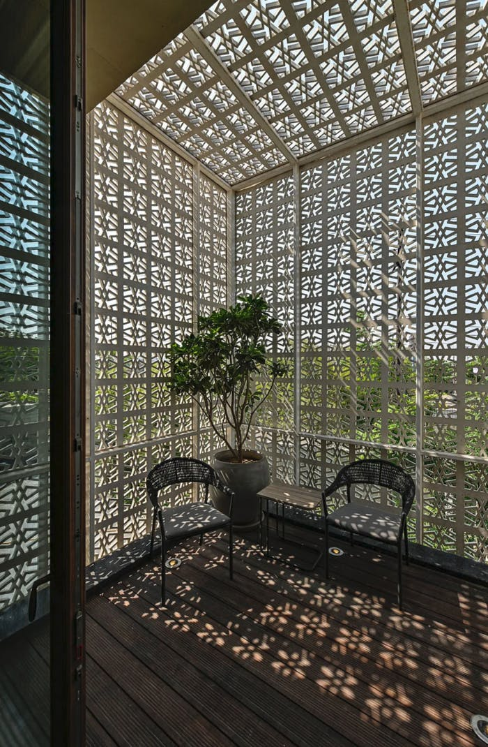"""Light filtering through the holes of a wall in a sunroom.<span class=""""sr-only""""> (opened in a new window/tab)</span>"""
