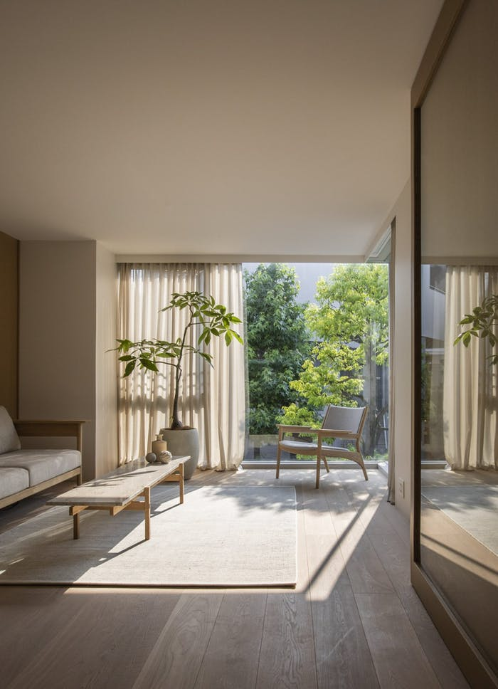 """Biophilic living room with minimal furniture and plenty of natural light.<span class=""""sr-only""""> (opened in a new window/tab)</span>"""