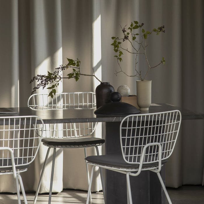 """View of a table with natural light filtering from outside.<span class=""""sr-only""""> (opened in a new window/tab)</span>"""