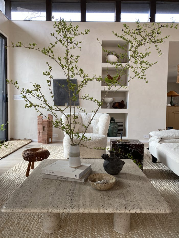 "Biophilic living room with plenty of soft juxtaposed textures and an oversized branch decorating the space.<span class=""sr-only""> (opened in a new window/tab)</span>"