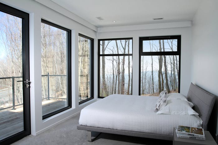 "Small bedroom with large windows that make the room look bigger.<span class=""sr-only""> (opened in a new window/tab)</span>"