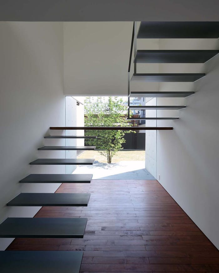 "A floating staircase with no railing.<span class=""sr-only""> (opened in a new window/tab)</span>"