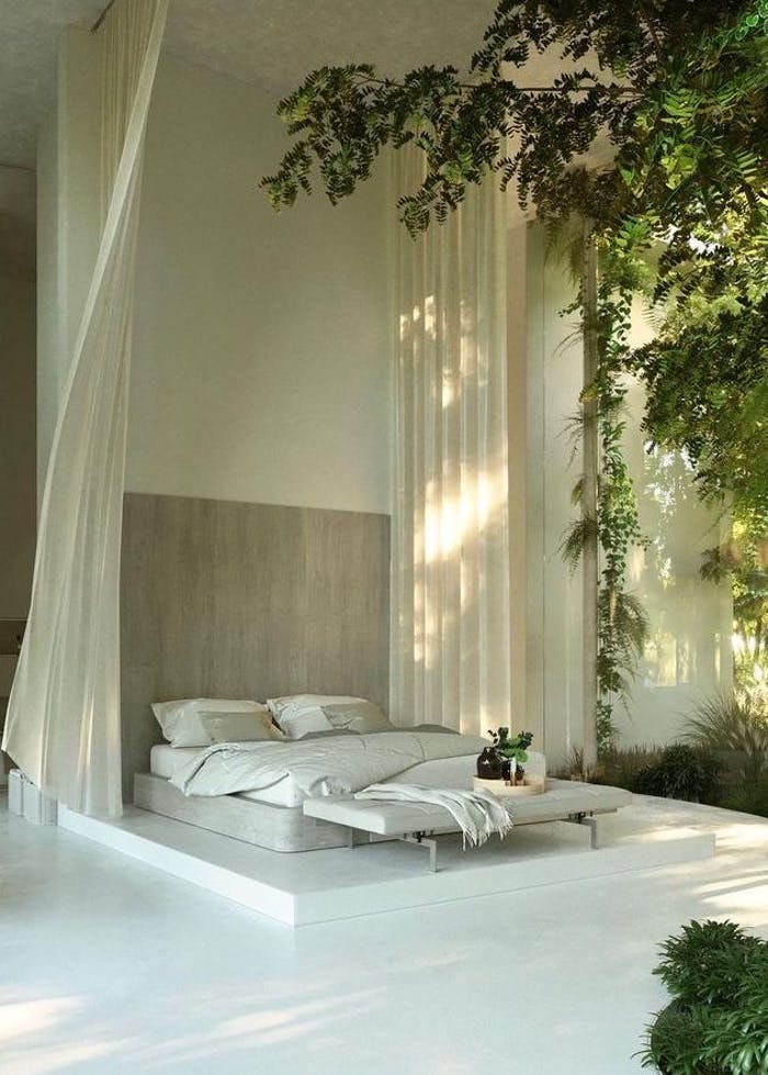 """Biophilic bedroom inspiration with the bed immersed among greenery.<span class=""""sr-only""""> (opened in a new window/tab)</span>"""